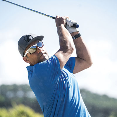 A golfer wearing Bolle sunglasses